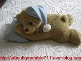 peluche ours qui dort