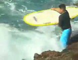 Ouch! Surfer Washed up on Rocks