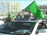 Tripoli: donné pour mort, le fils de Kadhafi apparaît en public