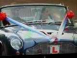 Prince William and Kate Middleton driving off in Aston Martin
