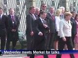 Medvedev, Merkel meet for energy, rights talks