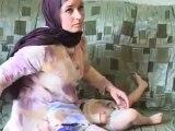 Versets du Coran sur la jambes d'un bébé en russie.