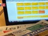Deux journalistes de Rue89 (de droite) testent l'appli budget du Figaro.fr