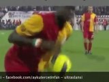Emmanuel Eboue tries to avoid  lighters, coins and stones
