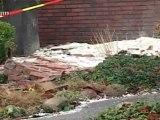 Storm houdt huis: gevel huis stort in