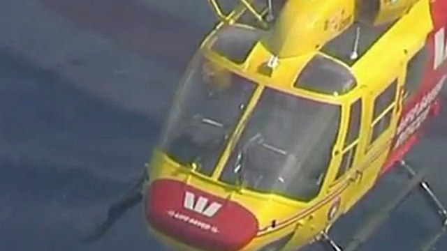 Stranded Australians cling to cool box after boat sinks