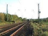 BR 140 mit Schüttgutwagen nach Süden und BR 143 mit Dostos nach Norden bei der Rheinbreitbacher  Kurve