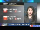 Asian markets end lower as China drops growth forecast