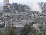 فري برس   هاام لحظة سقوط القذائف وتصاعد الدخان من المنازل حمص حي الخالدية 3 4 2012
