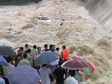 Taxi driver rescued from flooded river in China by crane