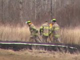 Grass Fire behind Revive Auto Shediac Rd. MFD on scene