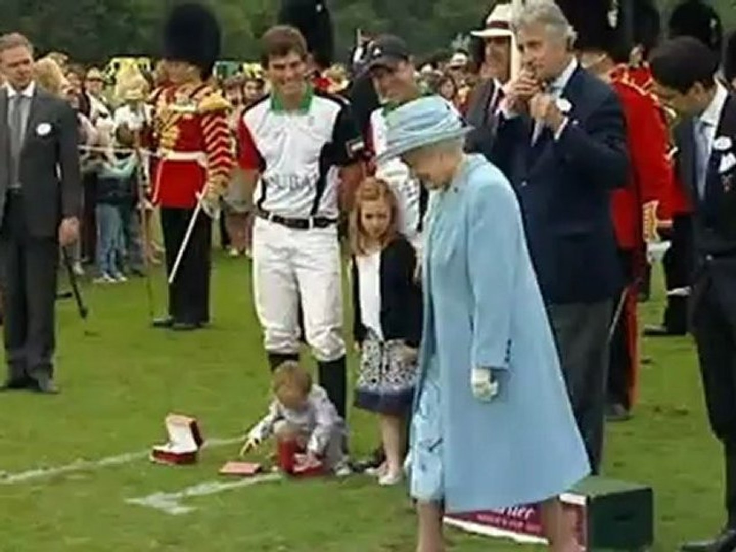 Queen sports a bloodshot eye at polo match