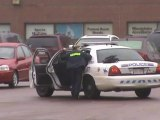 RCMP checking Male Shoppers Parking lot