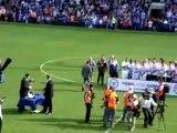 Darragh MacAnthony receives thanks from Darren Ferguson as chants rip through the football stadium