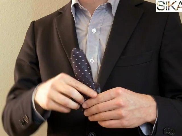 Plier une pochette pour costume - cravate : faire un pli bouffant
