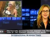 Topless Female Protester Brings Down Orthodox Cross with Chainsaw