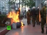 Greece riots: Video of violent clashes as cops tear-gas protesters in Athens