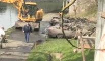 Roux: 40 voitures retirées du canal