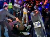 Police and anti-austerity demonstrators clash in Spain.