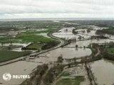 Floods spread across UK