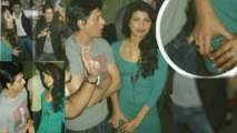 Priyanka Chopra CAUGHT putting her hands in Shah Rukh's clothes