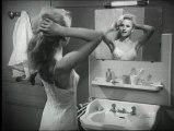 Madame Valentin, 3ème gauche 1959 Une femme au foyer s'informe au salon des arts ménagers sur appartement de type HLM équipé du confort moderne