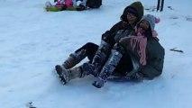 Snow fail! Kids on sledge knock woman off feet