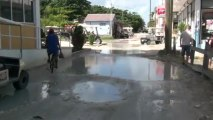 Belize living: bike traversing wet streets to Grand Baymen
