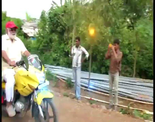Director Raghavendra Rao riding bike