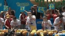 Joey 'Jaws' Chestnut eats 69 hot dogs to break own world record - video