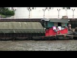 Close view of a cargo barge on river in Bangkok