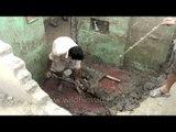 Labourers collecting silt: Uttarakhand flood