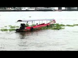 Longtail boat on the Chao Phraya river which flows through Bangkok