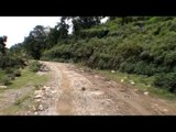 Driving on the damaged roads of Guptkashi