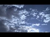 Clouds moving in fast motion over the American cities - Time Lapse