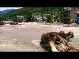 Partially damaged houses in Agustmuni after flash flood in Uttarakhand
