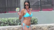 Claudia Romani showering in a blue bikini