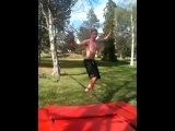 Acrobatic Youth Performs Backflip on Slackline