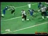 Football Player Hurdles Defender