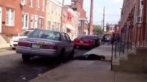 Weird Guy Attacks Car, Knocks Himself Out!