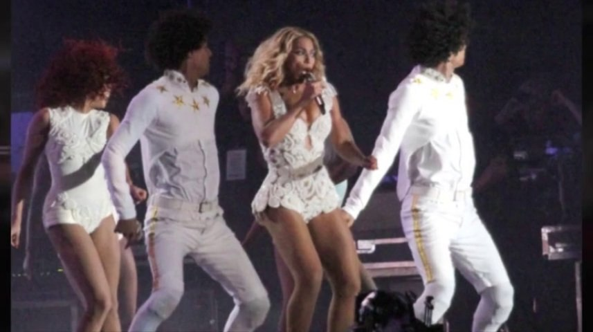 A fan pulls Beyoncé off the stage during her concert in Brazil!