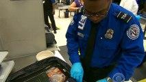 Checked bag fees cause airport headaches