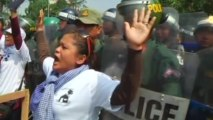 Cambodian protesters scuffle with police during protests over land evictions