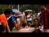 Referee teaching arm wrestling rules: At the 50th Naga Fest'13