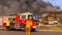 Australia bushfires destroy scores of homes