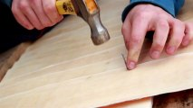 881_Cedar_wooden_shingle_shake_of_guy_nailing_in_a_wood_plank