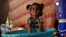 Miles de niños sirios viven refugiados sin sus padres