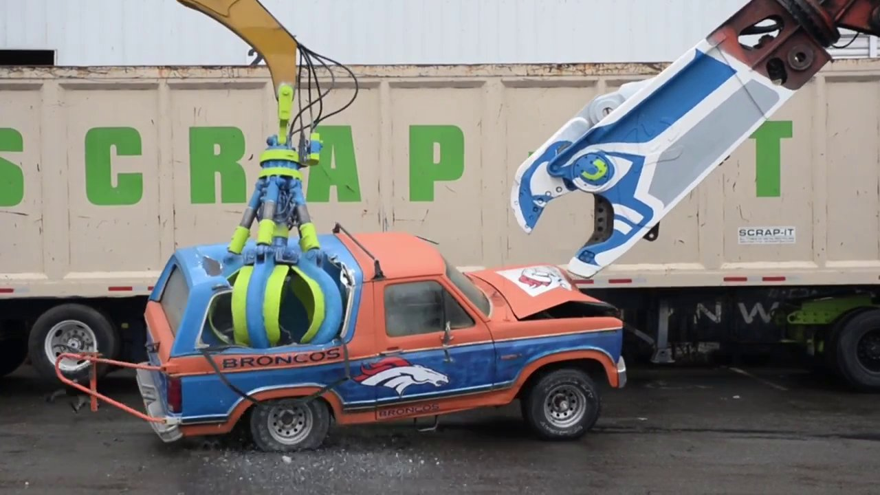 Seahawks fans obliterated a Ford Bronco with heavy machinery!! Superbowl XLVIII