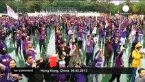 HundredsofforeigndomestichelpersinHongKongdanceforjustice