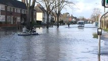 Oxford floods: residents take to dinghy as road floods
